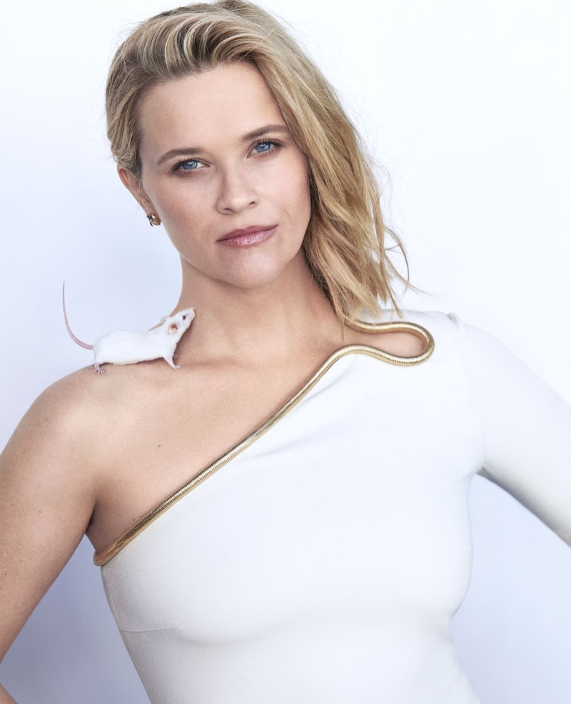 Dressed in white, Reese Witherspoon wears Stella McCartney dress and Bulgari earrings