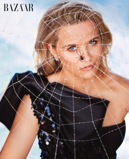 Actress Reese Witherspoon poses in Dolce & Gabbana dress with Tiffany & Co. earrings