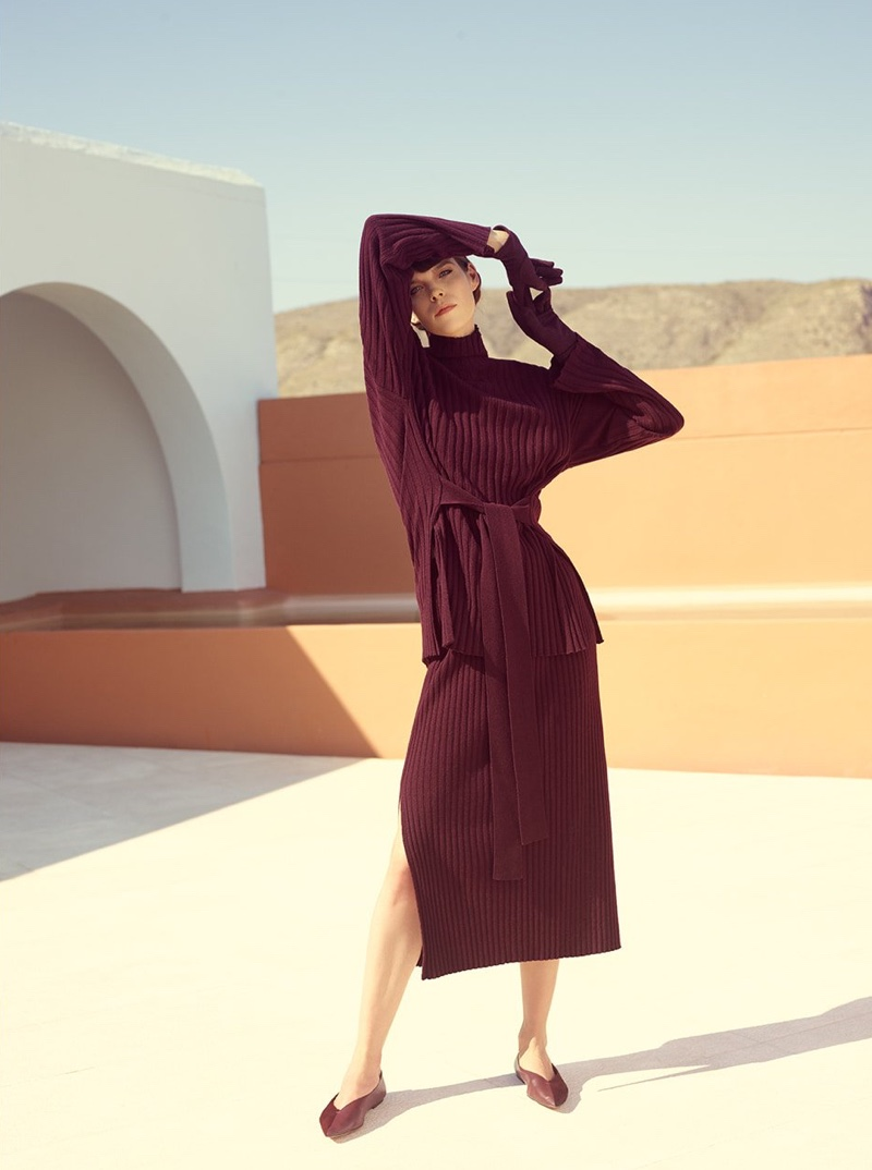 Model Meghan Collison poses in wool and cashmere top and skirt from Reserved Premium fall-winter 2019 collection
