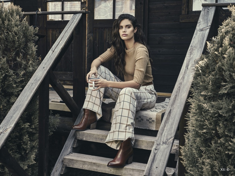 Model Sara Sampaio wears boots in XTI Shoes fall-winter 2019 campaign