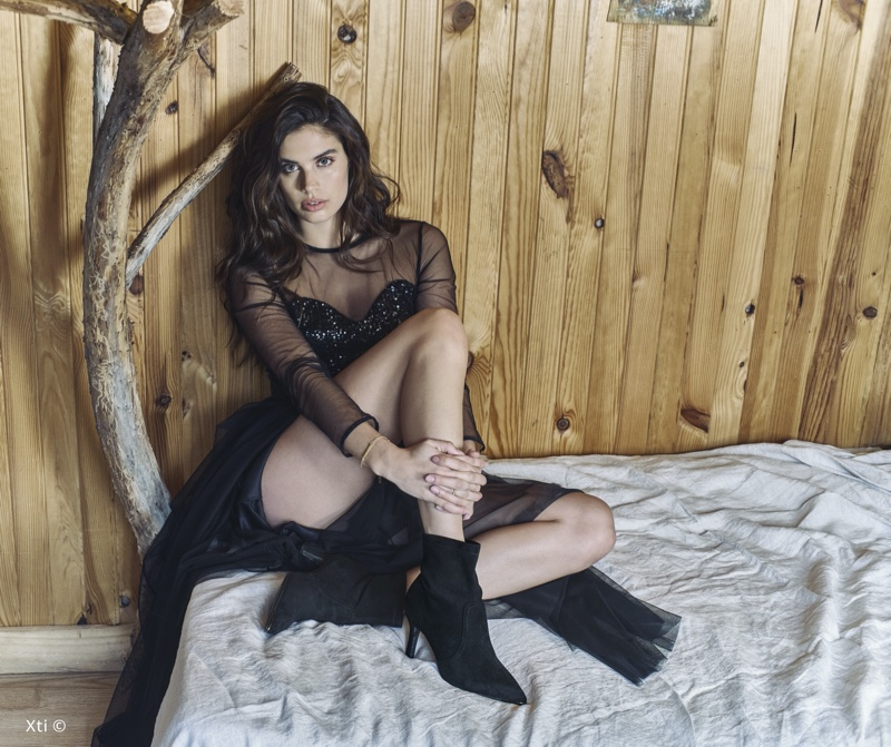 Rocking black booties, Sara Sampaio appears in XTI Shoes fall-winter 2019 campaign