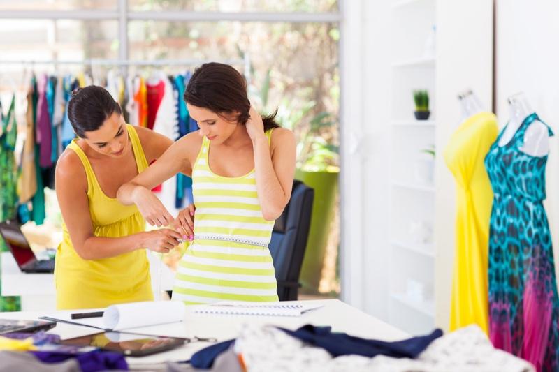 Seamstress Measuring Client Dresses