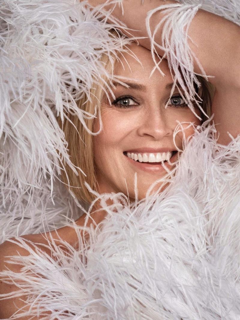 All smiles, Sharon Stone poses in Oscar de la Renta dress