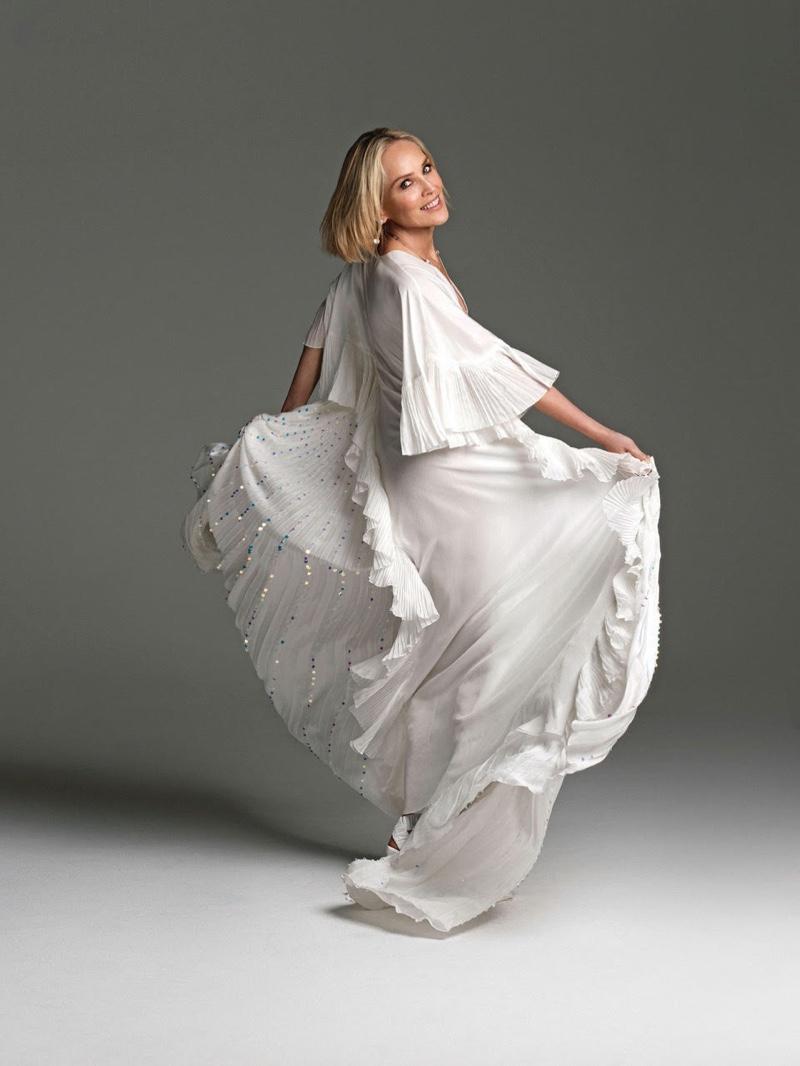 Sharon Stone twirls in Alberta Ferretti dress
