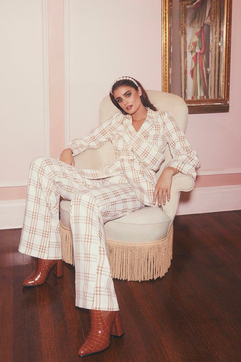 Suiting up, Taylor Hill wears checkered pantsuit from Boohoo collaboration