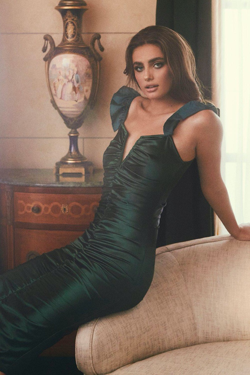 Model Taylor Hill wears emerald green dress from Boohoo collaboration