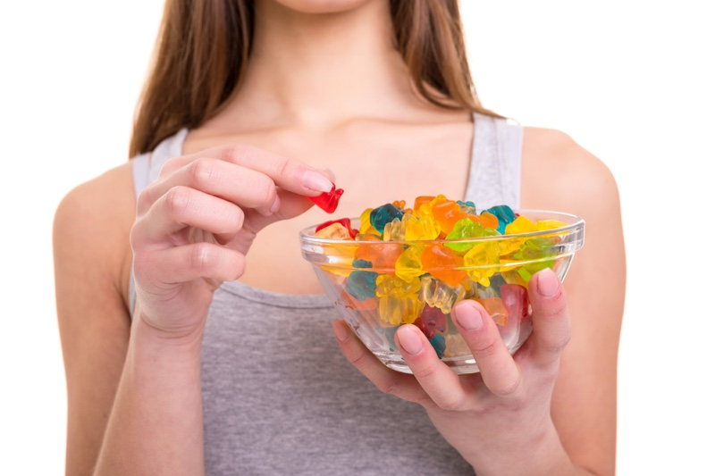 Woman Holding Bowl Gummies