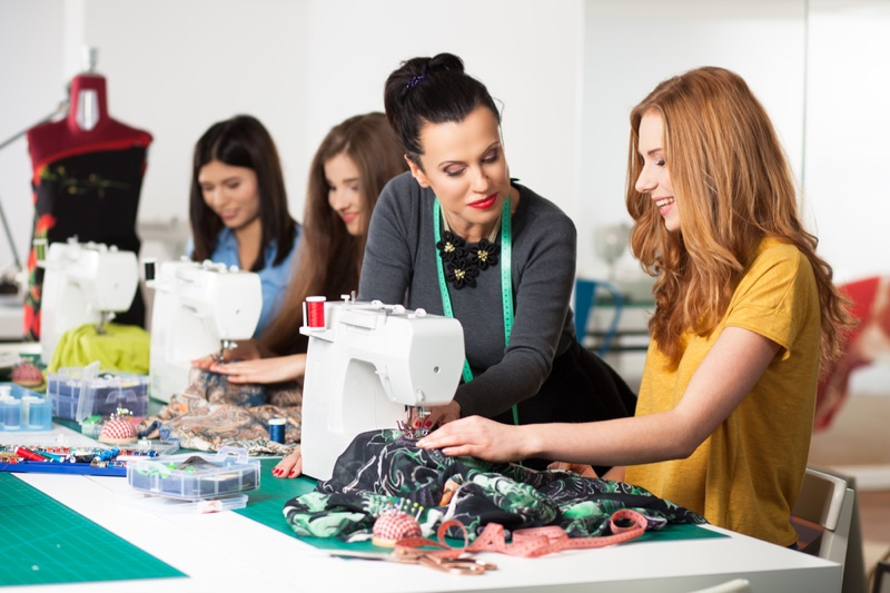 Woman Teaching Sewing Class Students
