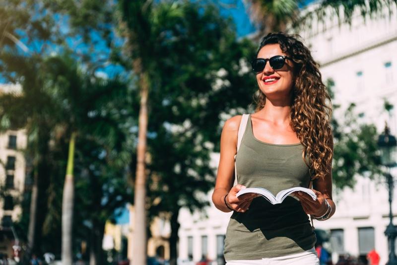 Woman Tourist Stylish Tank Top Sunglasses Smiling