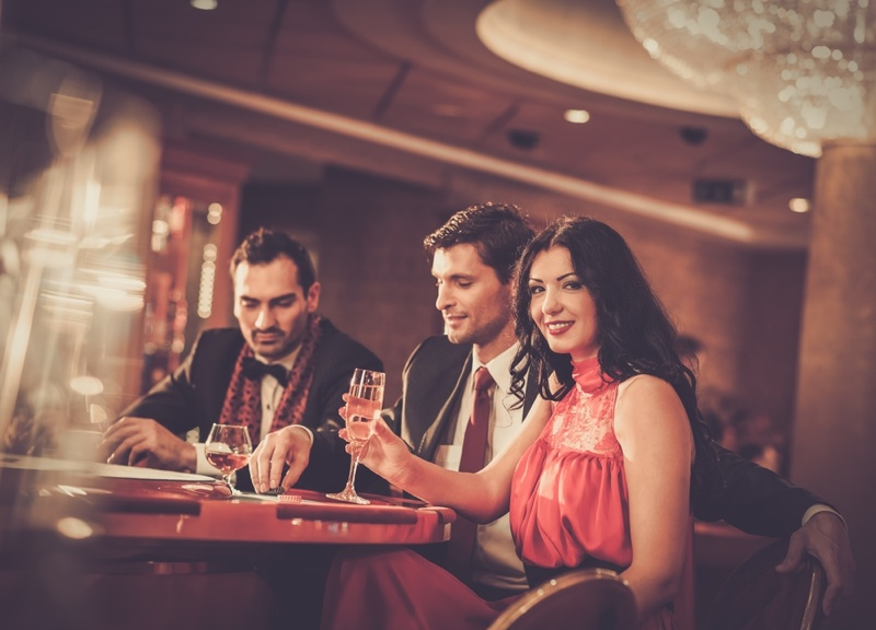 Woman Two Men Casino Table Drinks