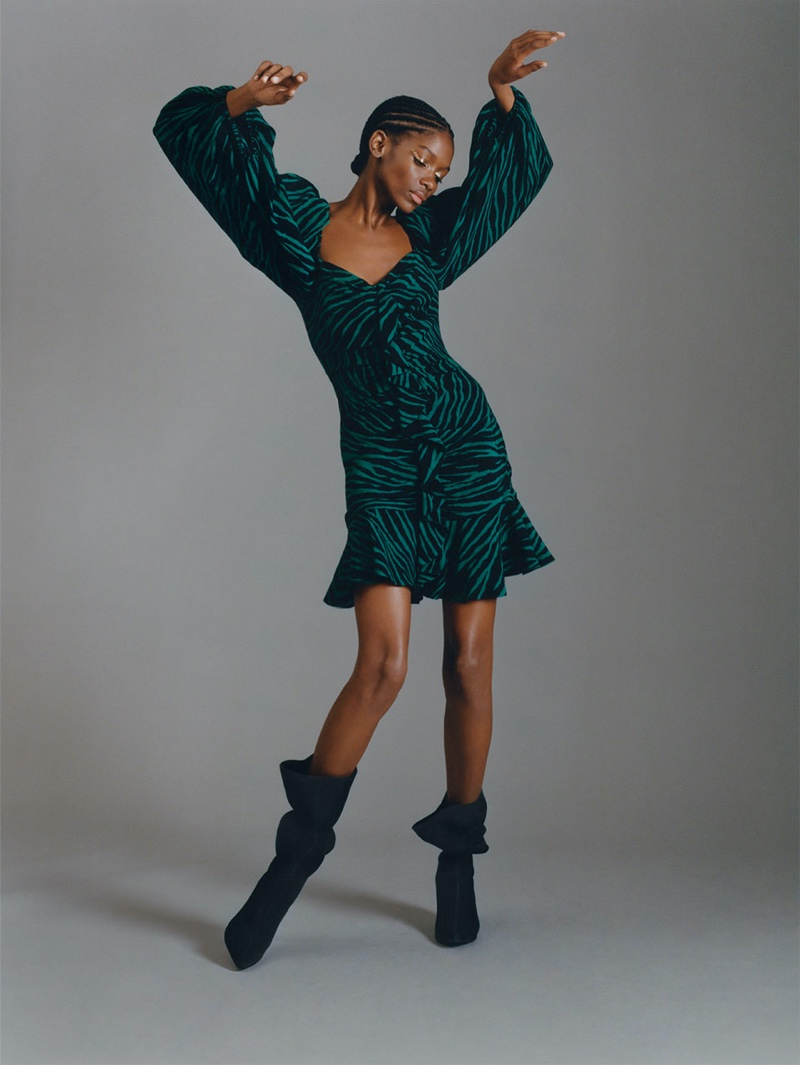 Elibeidy Dani poses in Zara Printed Dress with Ruffles and Split Leather Boots with Cone Shaped Heels