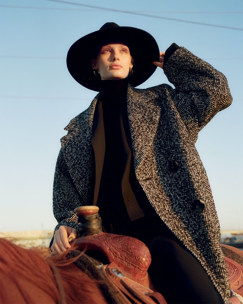 Posing on a horse, Kris Grikaite channels western style for Zara's fall 2019 coat edit