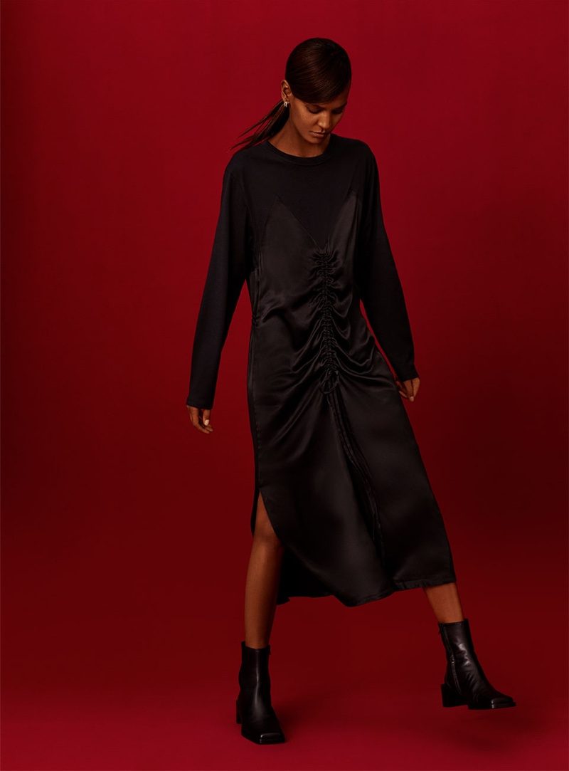 Model Liya Kebede wears Zara contrasting satin dress and leather square toe ankle boots