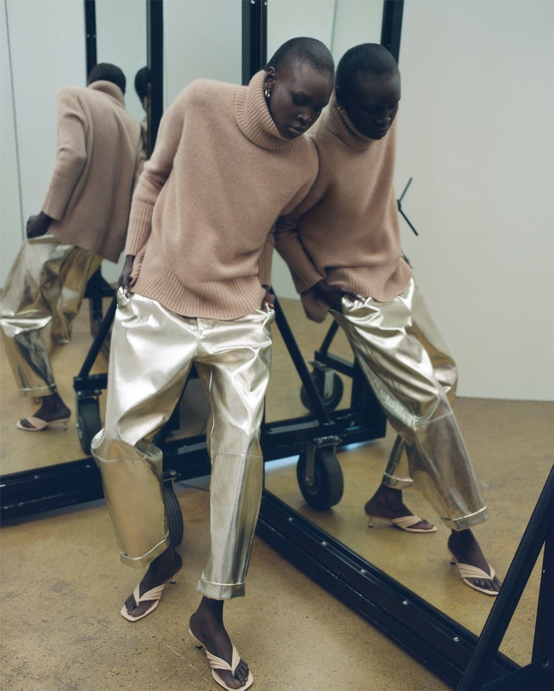 Alek Wek poses in Zara's fall-winter 2019 sweater selection