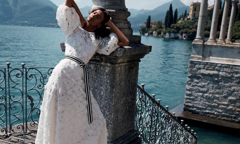 Model Liya Kebede wears Zimmermann Super Eight Lift Off blouse and skirt