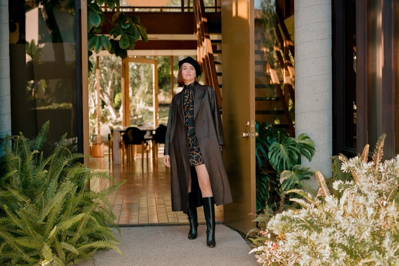 Zoey Deutch models Brunello Cucinelli trench coat, Maison Michel beret, Rokh blouse and Gianvito Rossi boots