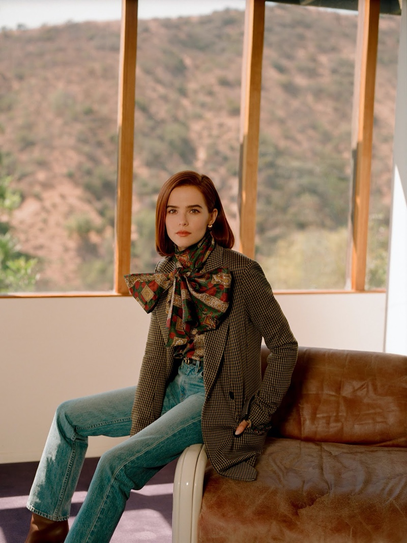 Actress Zoey Deutch poses in Rosetta Getty blazer, Etro blouse and SLVRLAKE jeans