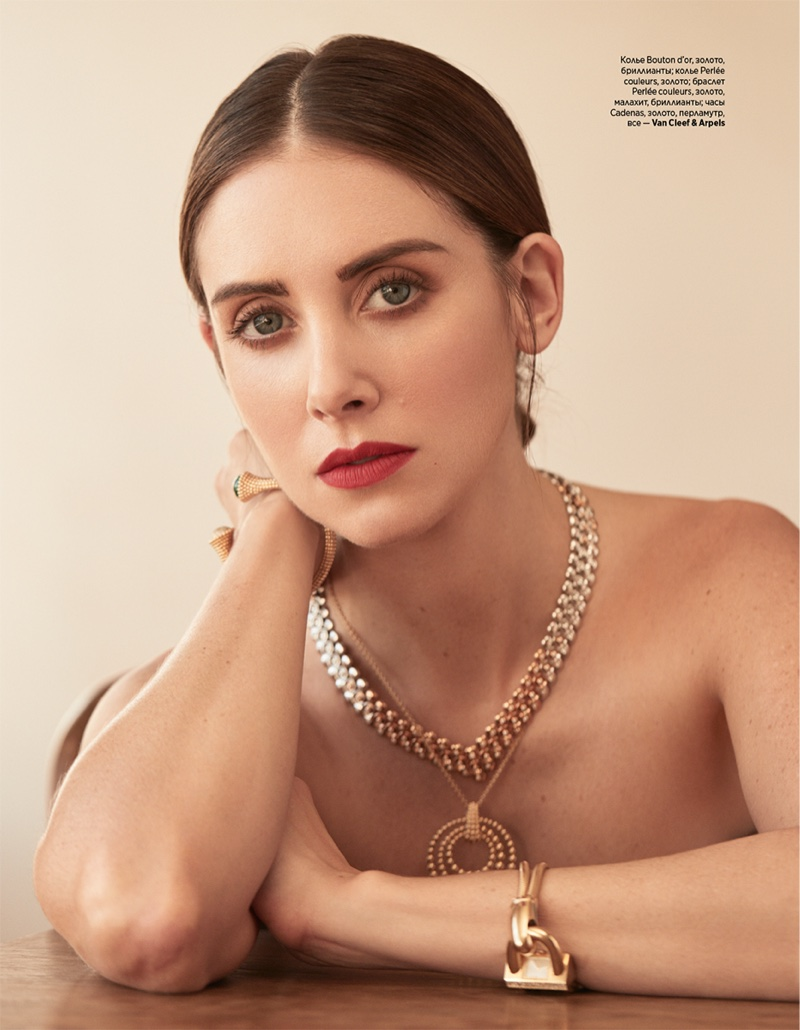 Wearing a red lip, Alison Brie shines in dazzling jewelry from Van Cleefs & Arpels