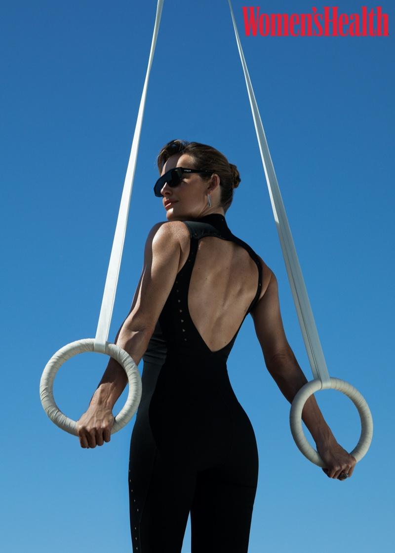 Posing on rings, Amy Purdy wears an all-black look