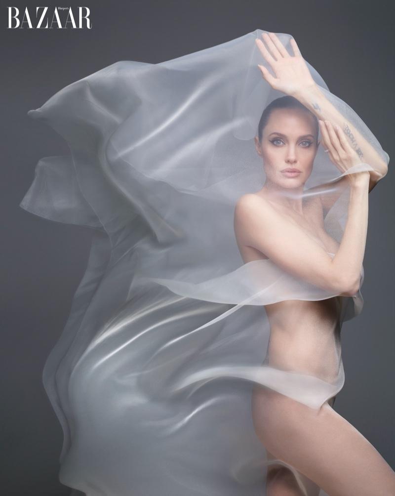 Posing in a sheer veil, Angelina Jolie wears Bulgari Serpenti ring
