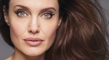 Ready for her closeup, Angelina Jolie poses in Oscar de la Renta dress