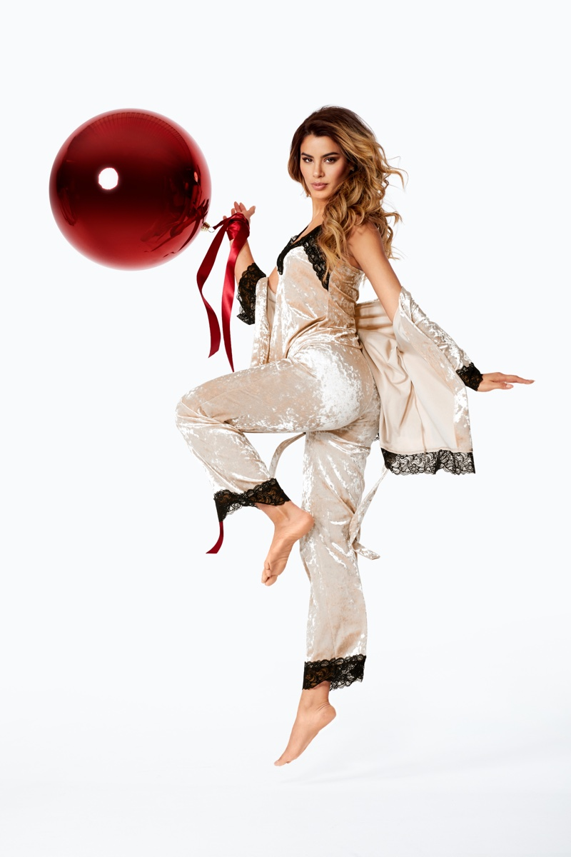 Posing with an oversized ornament, Ariadna Gutierrez appears in Bubbleroom.com Holiday 2019 campaign