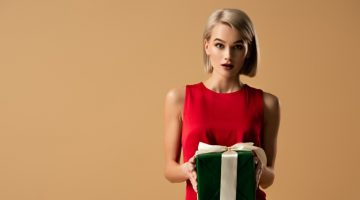 Blonde Holding Gift Box Green Red Dress