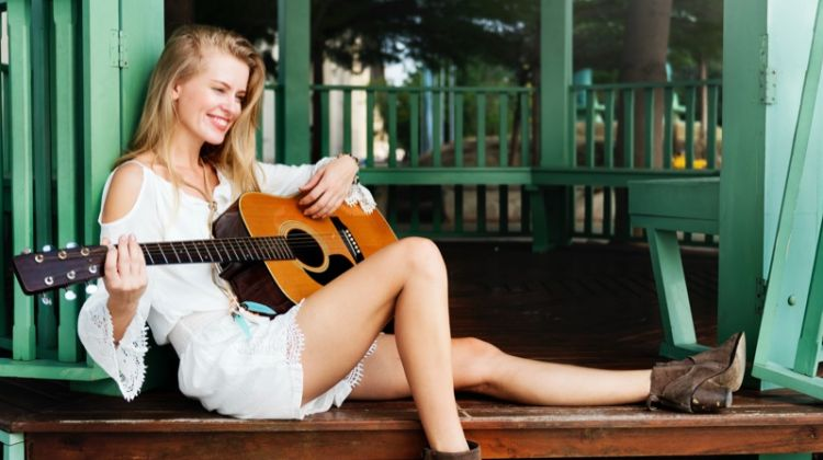 Blonde Musician Guitar Boots White Romper Smiling