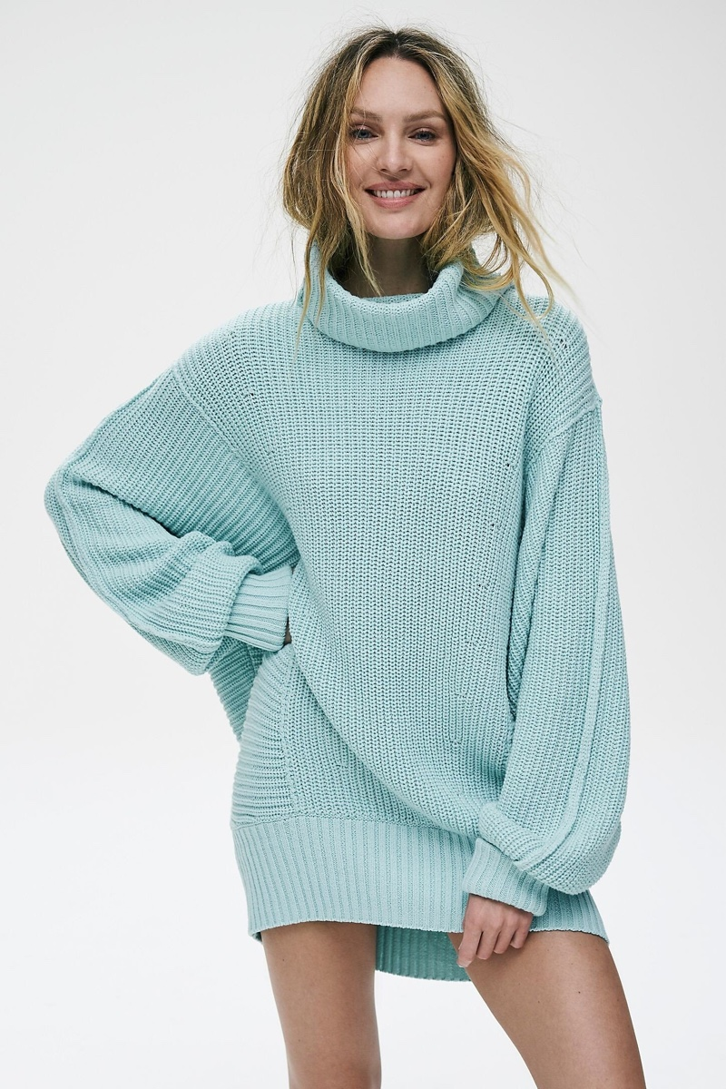 Candice Swanepoel wears Free People Cocoa sweater