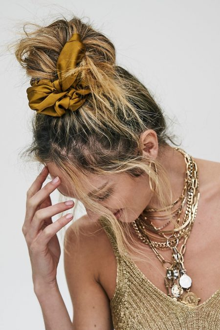 Candice Swanepoel Layers Up in Free People's Holiday Styles