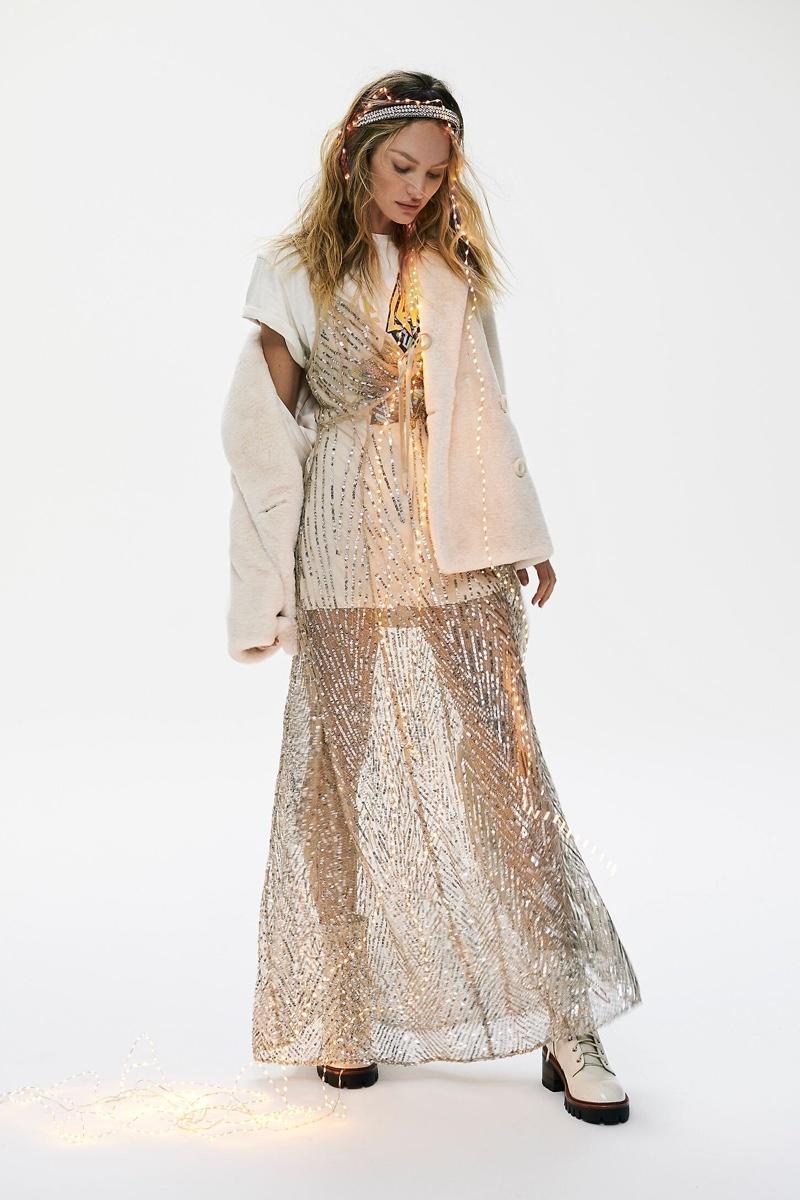 Model Candice Swanepoel wears Intimately Free People Sparks Fly embellished maxi slip dress