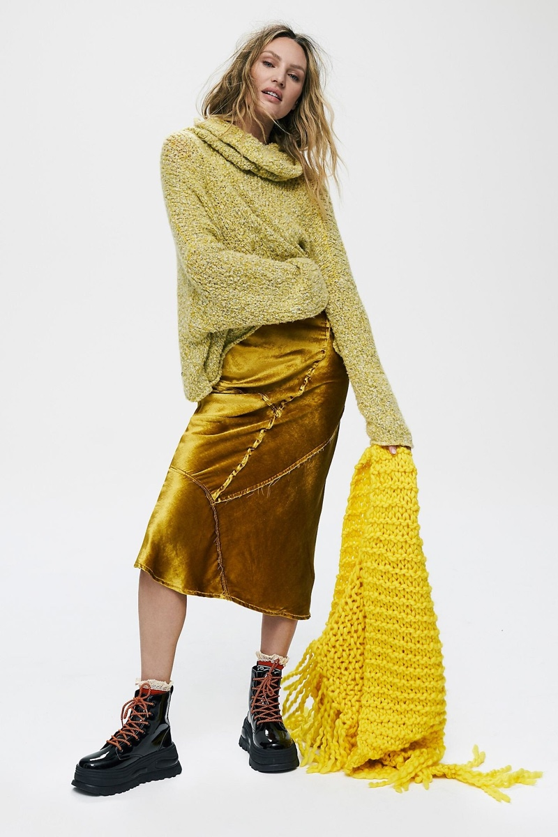 Layering up, Candice Swanepoel tries on green styles from Free People