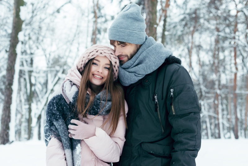 Couple Outdoors Snow Smiling Jackets Hats