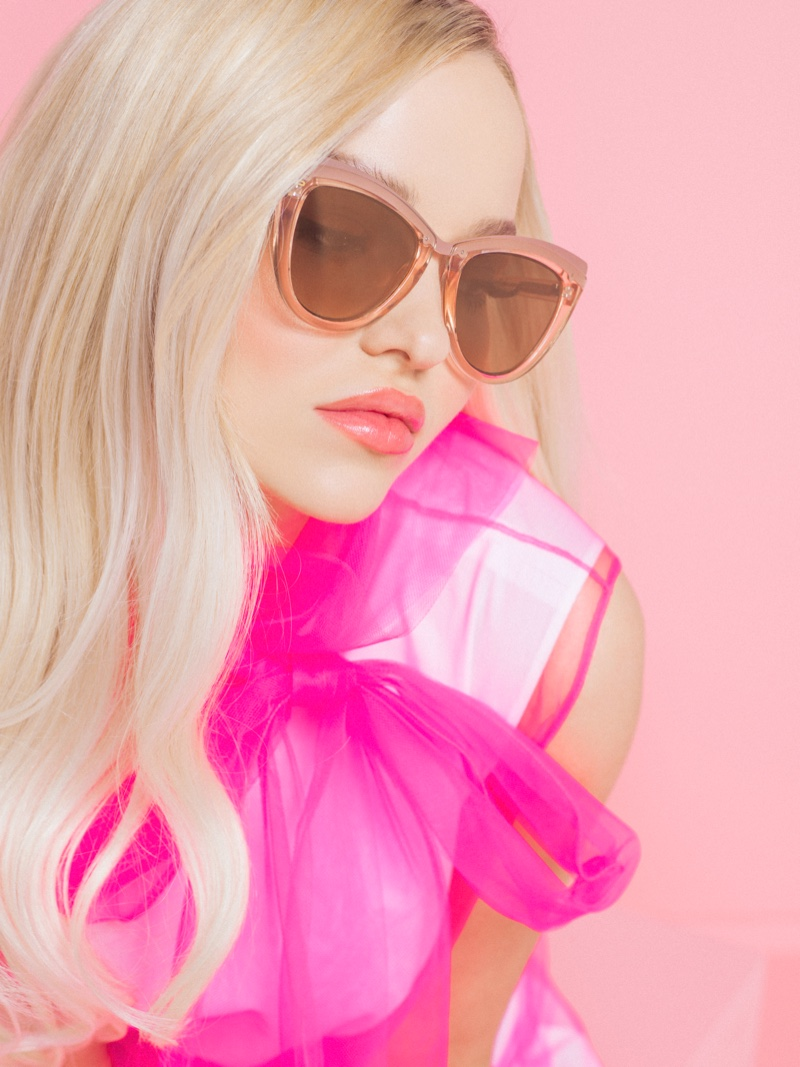 Actress and singer Dove Cameron poses in The Celeste sunglasses from Prive Revaux collaboration