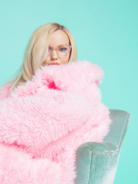 Dove Cameron Looks Pretty in Pink for Prive Revaux Collab