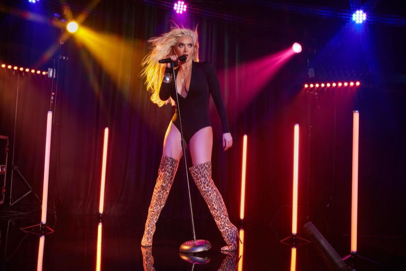 Rocking the stage, Erika Jayne poses in ShoeDazzle Holiday 2019 campaign
