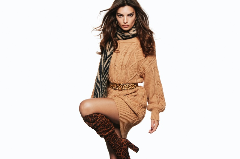 Emily Ratajkowski wears a sweater dress in Express Holiday 2019 campaign