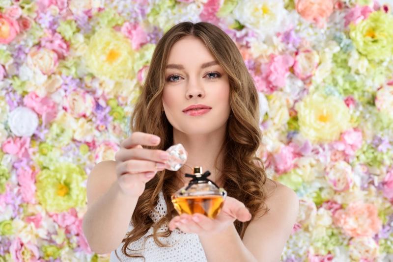 Flower Backdrop Model Holding Perfume Fragrance Bottle