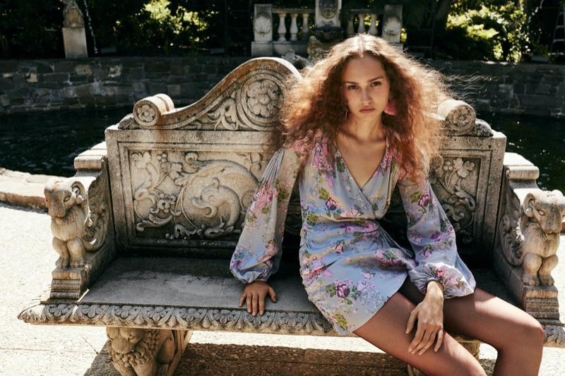 Michelle Gutknecht poses in For Love & Lemons Jardin mini dress