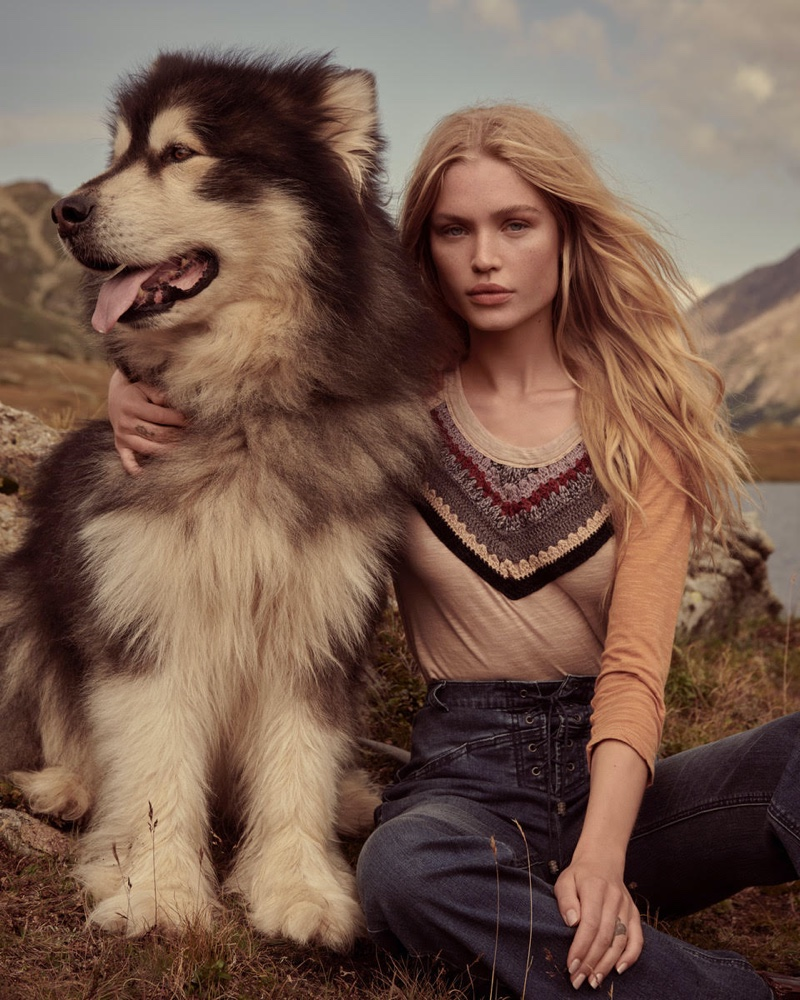 Posing with a dog, Camilla Christensen appears in Free People holiday 2019 campaign