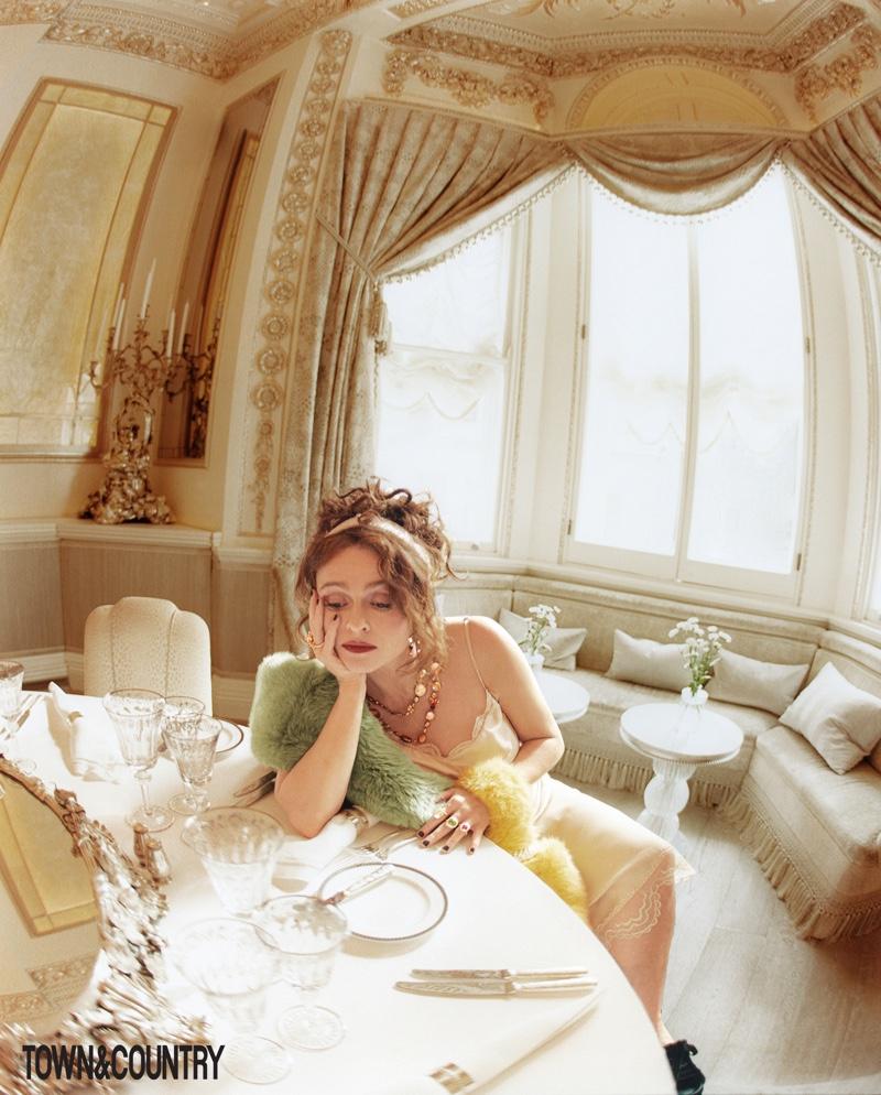 Actress Helena Bonham Carter wears Simone Rocha slip, Maison Atia stole and Shrimps handbag