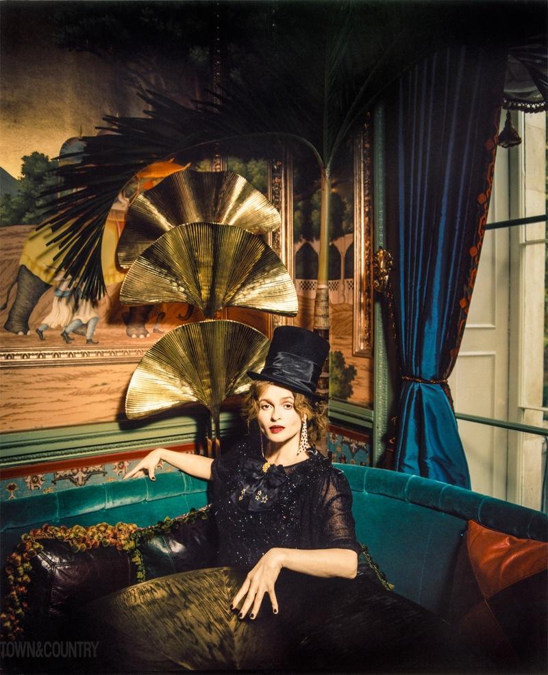 Posing in black, Helena Bonham Carter wears Graff earrings, Ryan Lo top, Comme des Garcons skirt and Ellen Christine Couture top hat