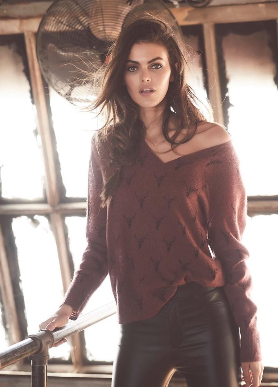 Model Kamila Hansen poses in Emerson sweater from Skull Cashmere