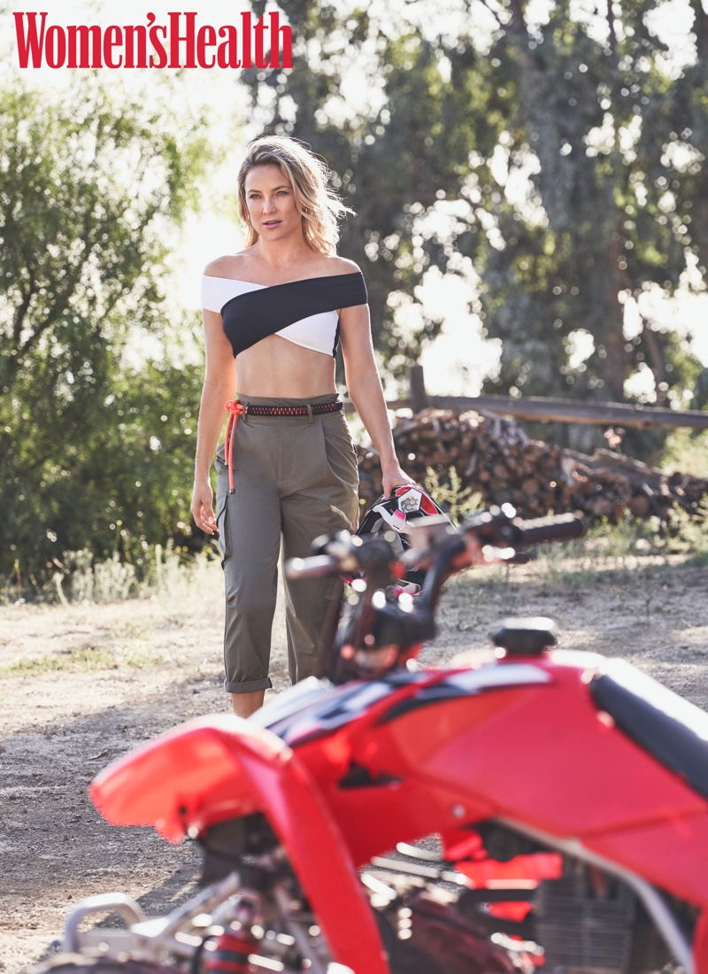 Posing outdoors, Kate Hudson wears Oye Swimwear bikini top and Zara pants
