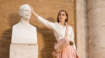 Kiernan Shipka poses in a statue for Fendi #BaguetteFriendsForever campaign