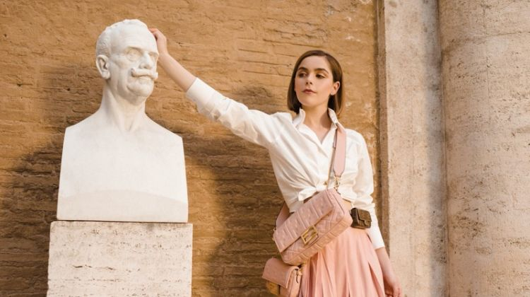 Kiernan Shipka poses in a statue for Fendi #BaguetteFriendsForever campaign