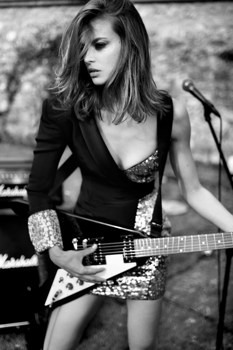 Posing with a guitar, Birgit Kos fronts Redemption fall-winter 2019 campaign