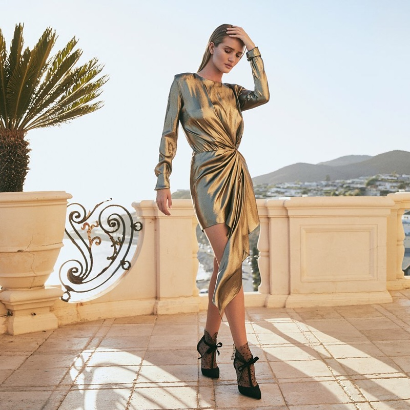Model Rosie Huntington-Whiteley poses in Jimmy Choo's resort 2020 collection