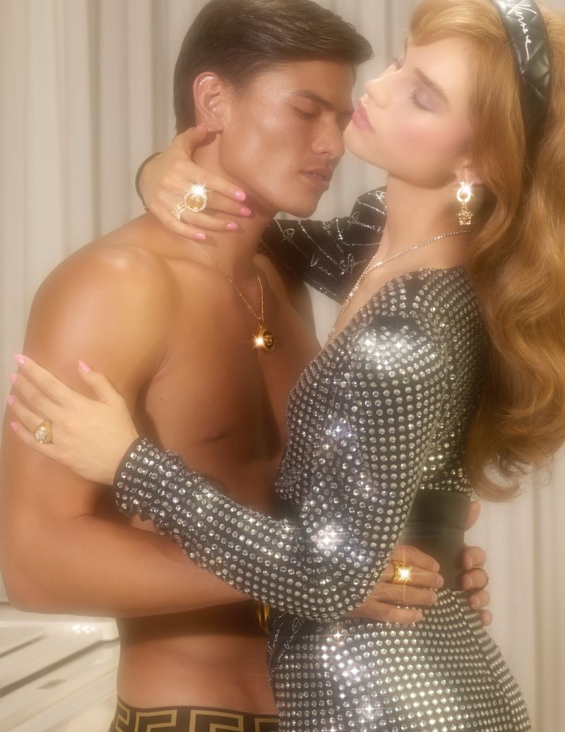 Models Simonas Pham and Meghan Roche embrace in Versace Holiday 2019 campaign