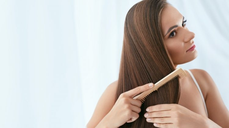 Woman Brushing Long Straight Brown Hair
